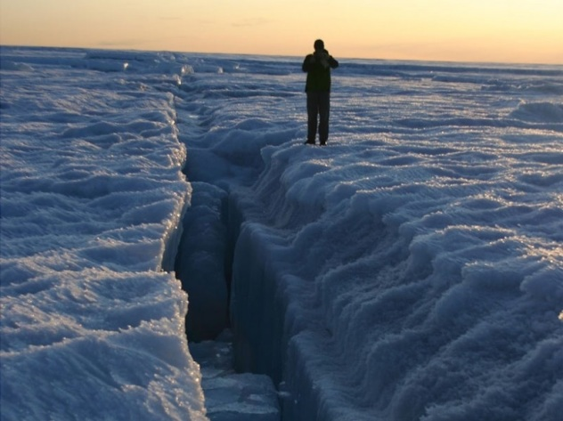 A hydrofractured crevasse, on the scalloped lake bottom of the supraglacial lake Greenland Ice Sheet in 2009. Credit William Colgan
